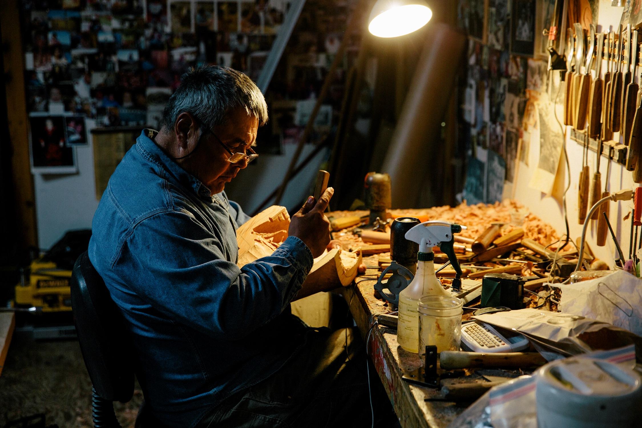 Reg Davidson, a local carver in his shop
